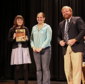 First prize winner, Katherine Blassingame (left) honored for her first prize win by VAS Board Member Christie Ertel and Head of Social Studies at St. Johnsbury Academy,David Eckhardt.